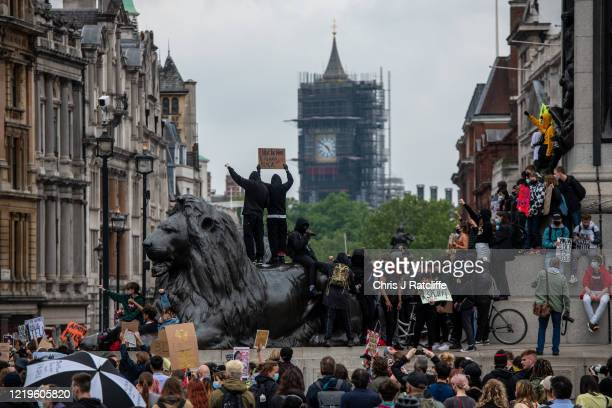 Black Lives Matter supporters gather in Trafalgar Square after marching from Hyde Park on June 12, 2020 in London, United Kingdom. The death of an...
