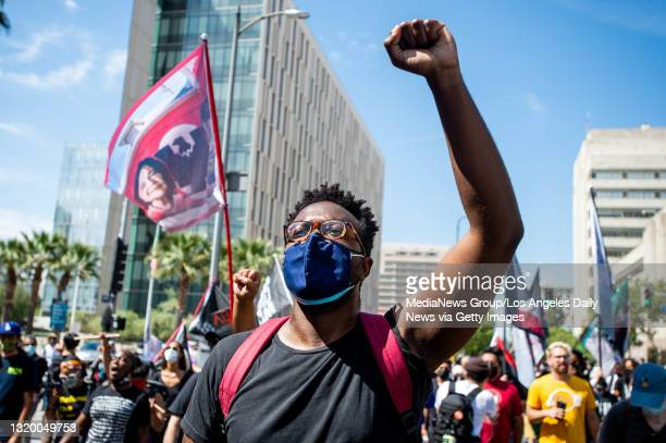 """Black Lives Matter supporters march through downtown Los Angeles on the first anniversary of George Floyd""""u2019s death on Tuesday, May 25, 2021. """"n"""