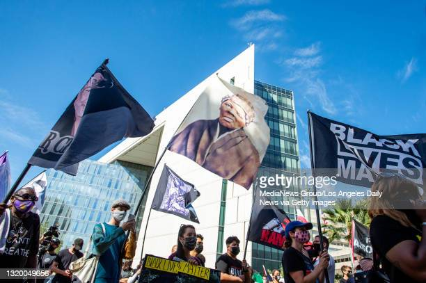 """Black Lives Matter supporters take to the streets in Los Angeles outside LAPD Headquarters during the first anniversary of George Floyd""""u2019s death..."""