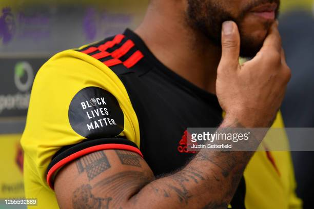 Black Lives Matters logo is seen on the shirt of Troy Deeney of Watford during the Premier League match between Watford FC and Newcastle United at...