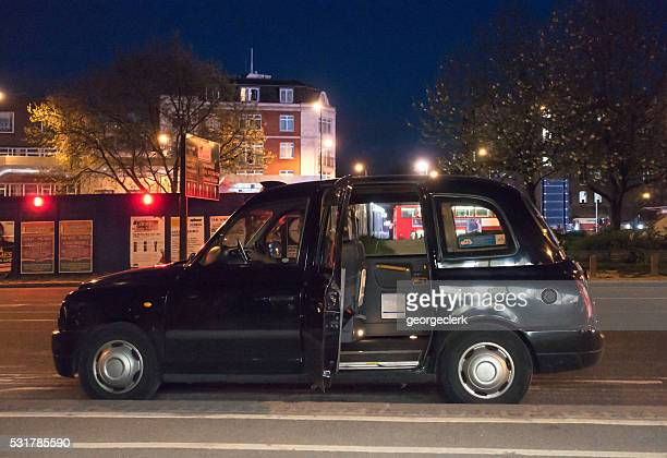 Black London cab waiting on the street