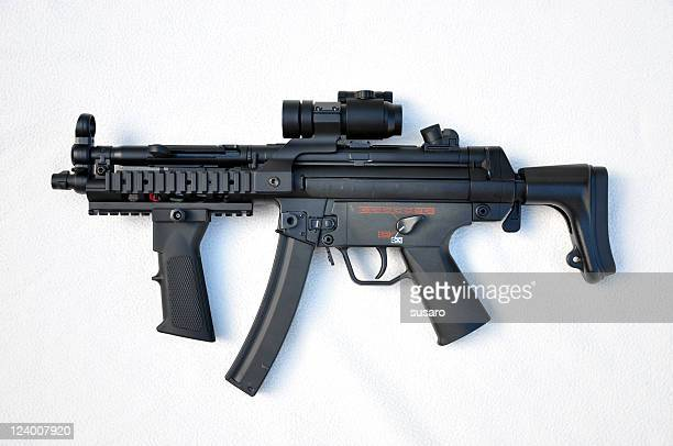 a black machine gun on a white background - machine gun stock pictures, royalty-free photos & images