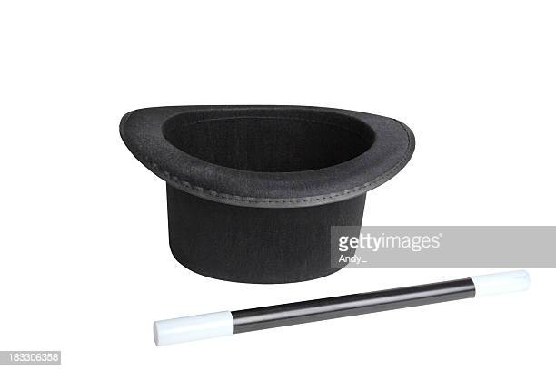 A black magicians hat and wand on a white background