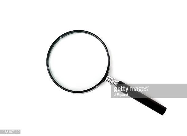 black magnifying glass on a white background - magnifying glass stock pictures, royalty-free photos & images