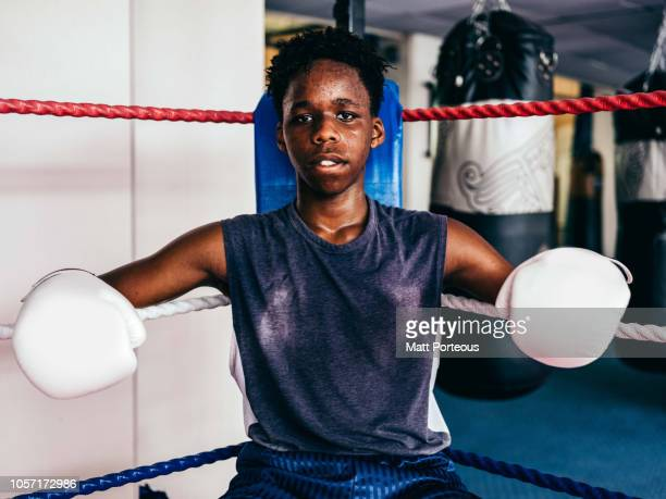 black male boxer portrait sat down - boxing ring stock pictures, royalty-free photos & images