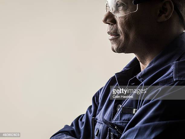 Black male in protective work clothes