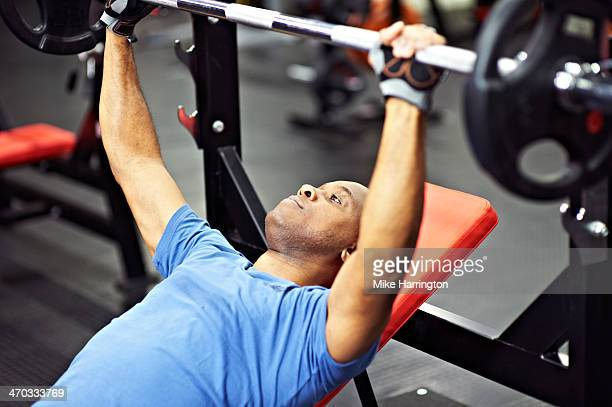 black male on bench press - glove stock pictures, royalty-free photos & images