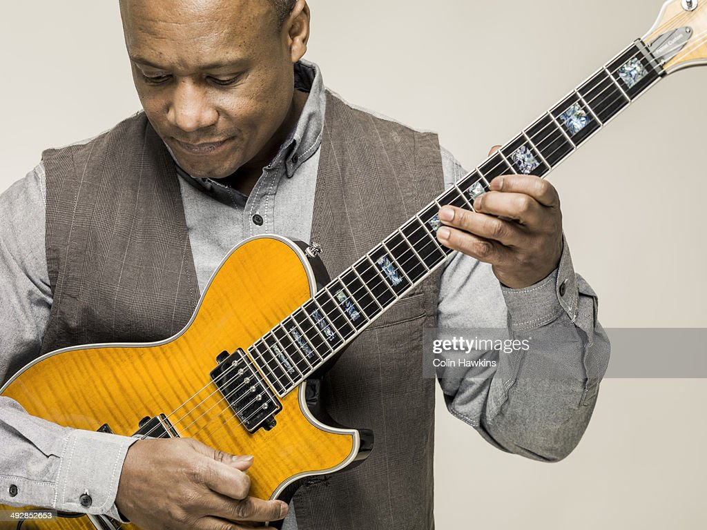 Black male playing guitar : Stock Photo