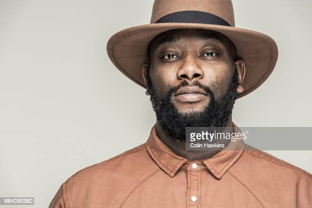 black male wearing hat - colin hawkins stock pictures, royalty-free photos & images