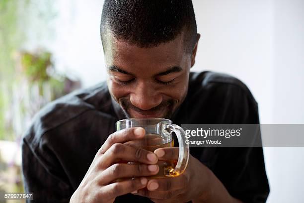 Black man drinking cup of tea