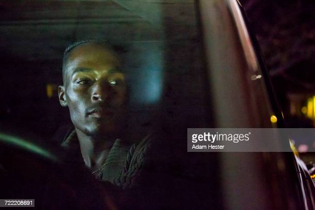 black man driving car - one man only stock pictures, royalty-free photos & images