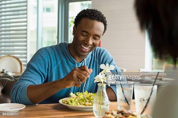 Black man eating breakfast in cafe