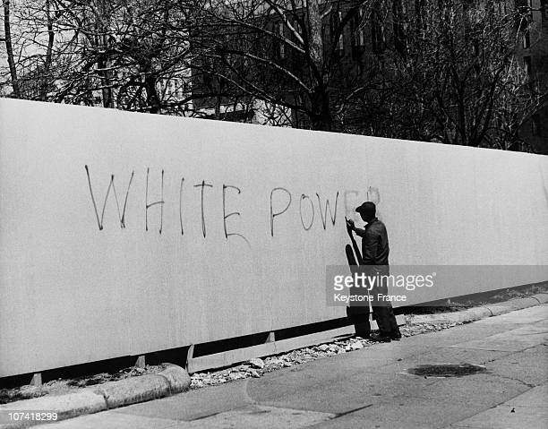 Black Man Erasing A Racistmessage On A Wall In Washington On March 1969