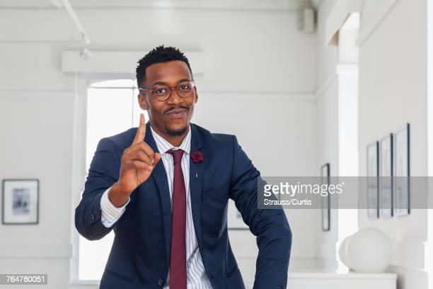 Black man gesturing in gallery