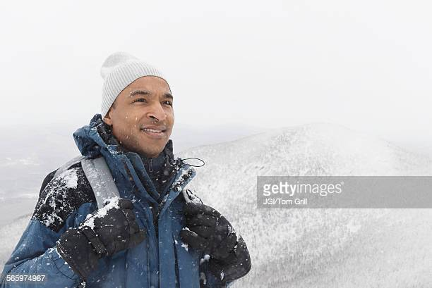 black man hiking in snow - black glove stock pictures, royalty-free photos & images