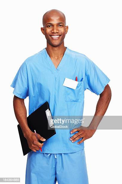 Black man in light blue scrubs holding clipboard and pen