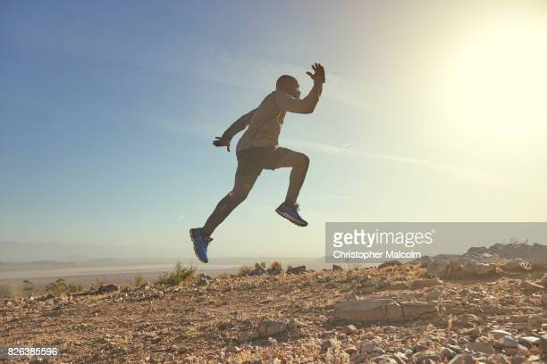 Black man jumps in the hills