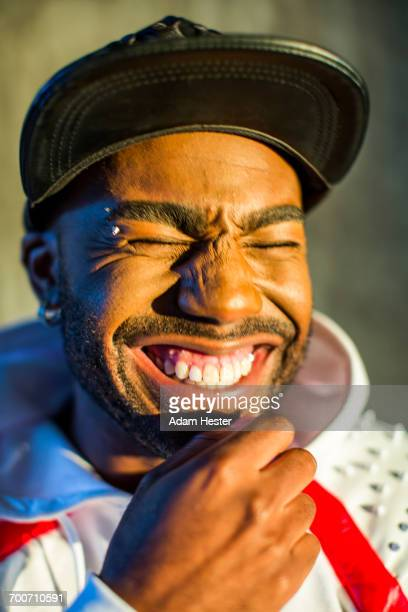 Black man laughing with eyes closed