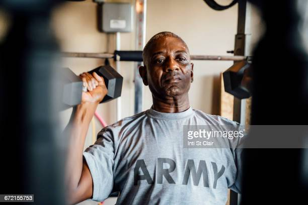 black man lifting weights in garage - military exercise stock pictures, royalty-free photos & images
