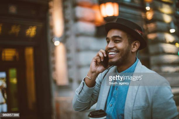 black man on the phone - smart casual stock pictures, royalty-free photos & images
