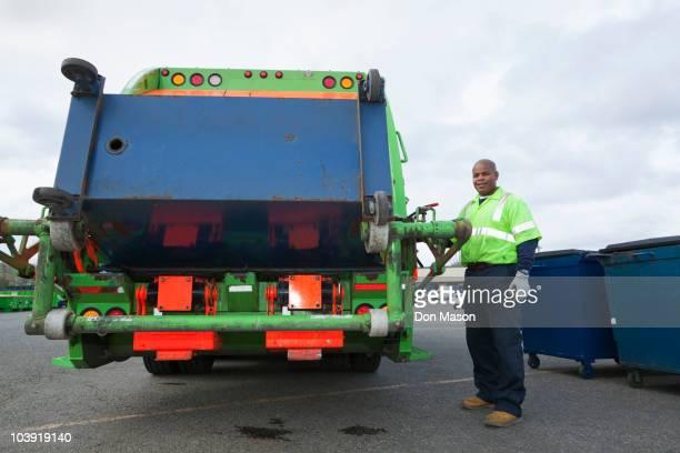 Black man operating garbage truck