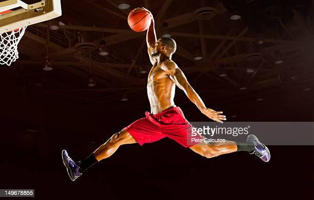 Black man playing basketball