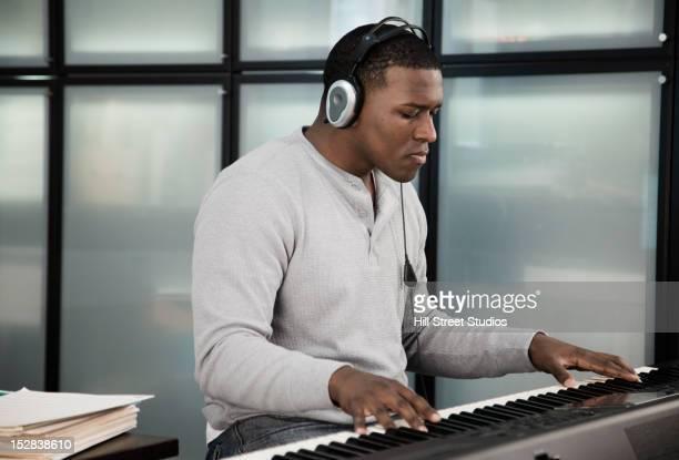Black man playing electronic keyboard