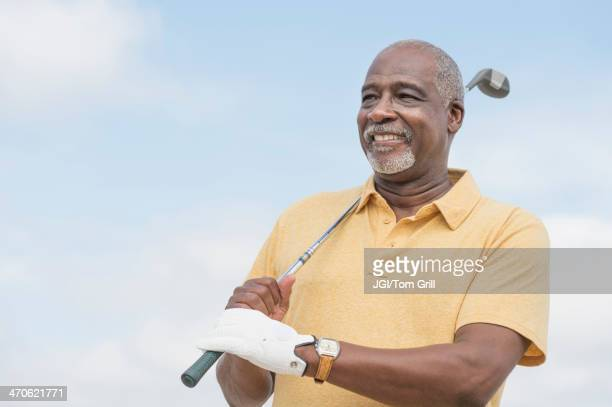 black man playing golf outdoors - golfer stock pictures, royalty-free photos & images