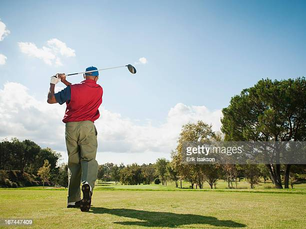 Black man playing golf