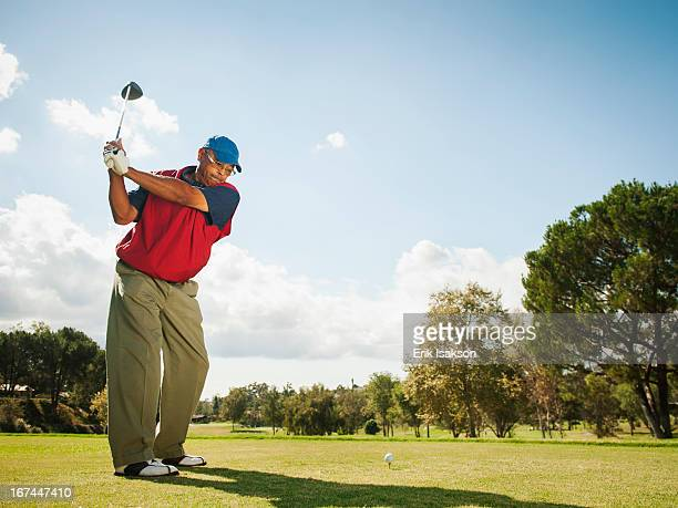 black man playing golf - teeing off stock pictures, royalty-free photos & images
