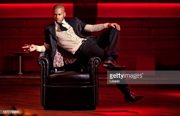 black man posing at the night club - most handsome black men stock photos and pictures