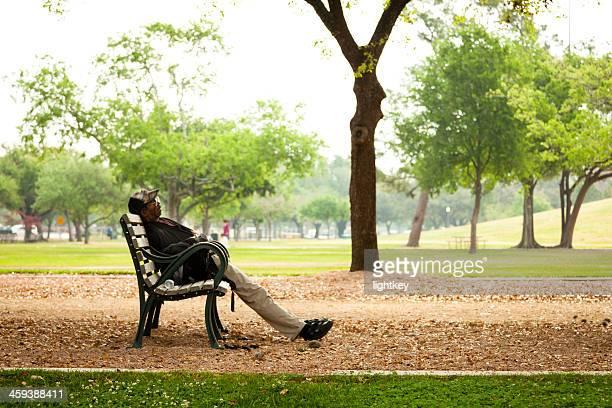 Black man resting on the bench