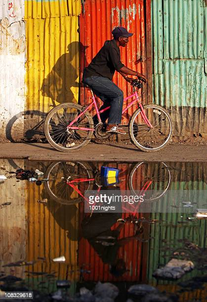 Black man riding bicycle