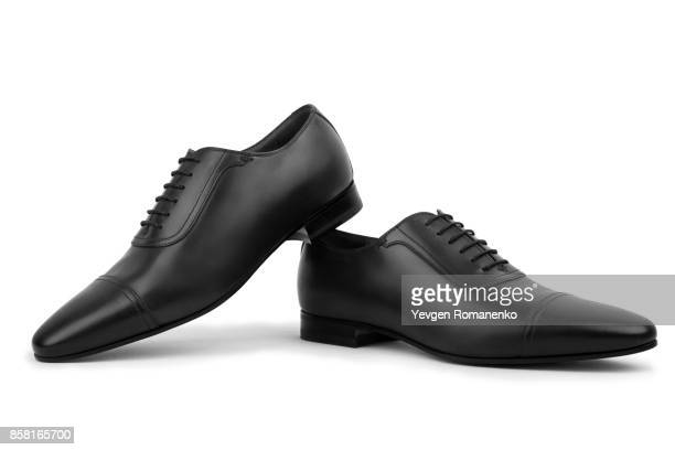black man shoes isolated on white background - black shoe stock pictures, royalty-free photos & images