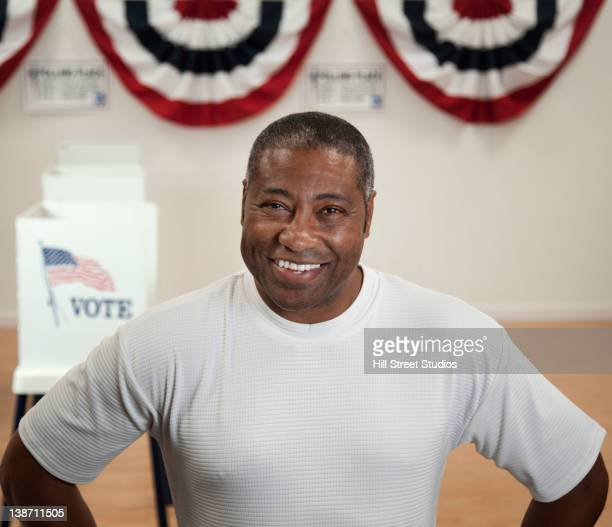 Black man standing in polling place
