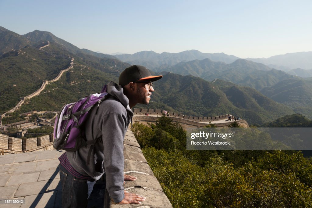 Black man standing on Great Wall of China, Beijing, Beijing, China : Stock Photo
