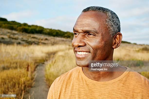 Black man standing on rural path
