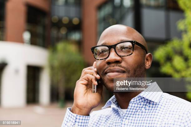 Black man talking on cell phone in city