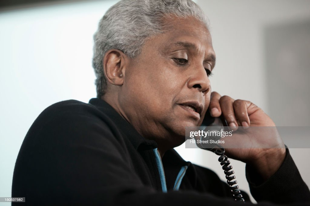 Black man talking on telephone : Stock Photo
