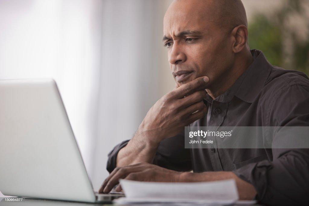 Black man using laptop : Stock Photo