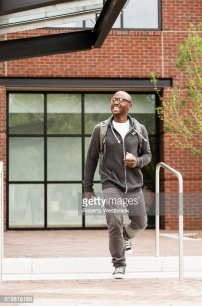 Black man walking in city
