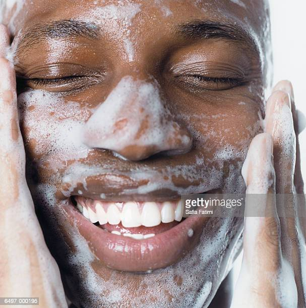 Black Man Washing his Face