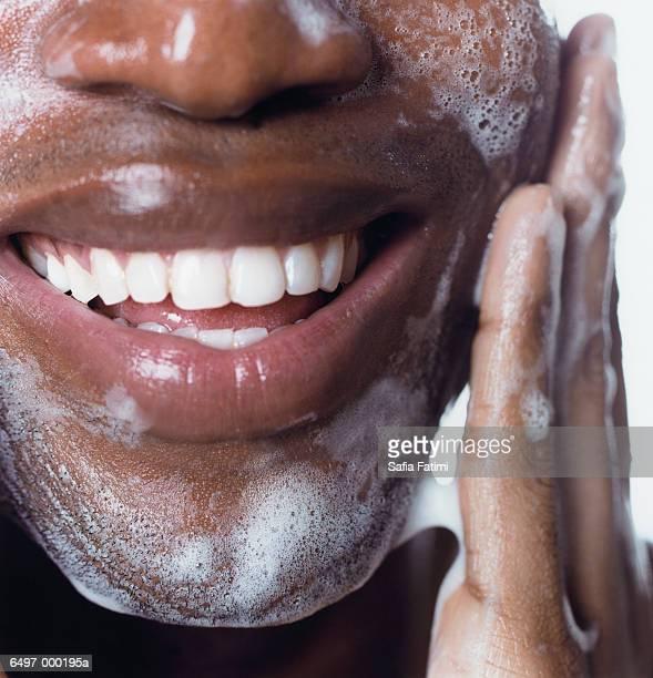 Black Man Washing his Face