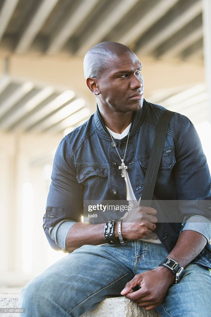 Black man wearing jewelry and denim : Stock Photo