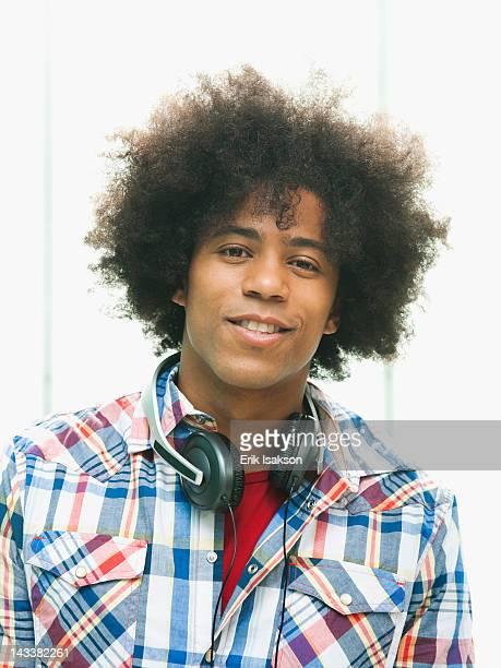 Black man with headphones around neck