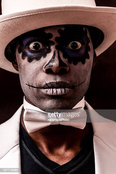 Black man with Sugar Skull makeup on his face (II)