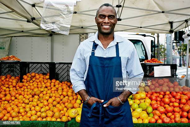 Black man working at outdoor market