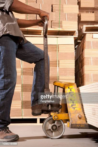 black man working in warehouse - boot stock pictures, royalty-free photos & images
