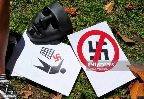 Black mask and anti Nazi sings on display during a rally to demonstrate against Fascism, Nazism and racism on July 25, 2020 in Lisbon, Portugal. The...