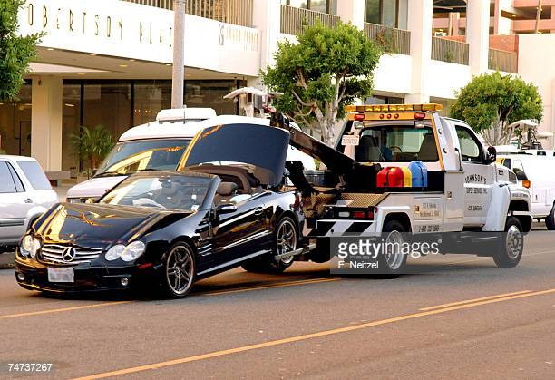 A black MercedesBenz driven by actress Lindsay Lohan is taken away by a tow truck after the actress collided with a van on Robertson Boulevard in...
